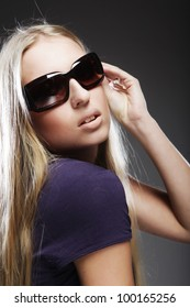 Studio shot of a young, beautiful, blond, fashionable woman