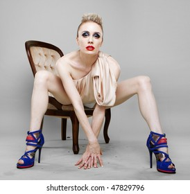 Studio shot of a young, beautiful, blond, fashionable woman