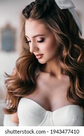 Studio shot of young beautiful bride on light studio background