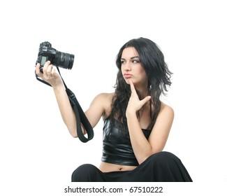 studio shot of young beautiful woman making self-portrait over white