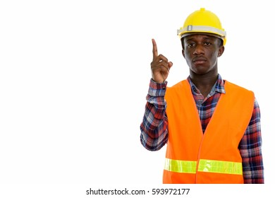 Studio shot of young black African man construction worker pointing finger up