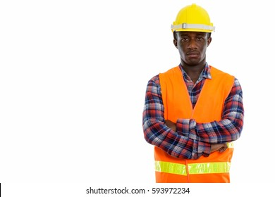 Studio shot of young black African man construction worker with arms crossed