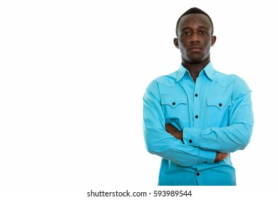 Studio shot of young black African man with arms crossed
