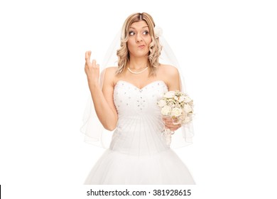 Studio shot of a young bride with her fingers crossed isolated on white background