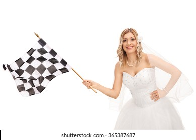 Studio shot of a young bride waving a checkered race flag and looking at the camera isolated on white background
