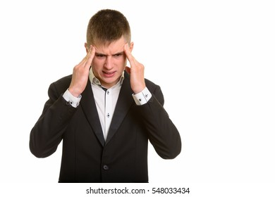 Studio shot of young businessman having headache isolated against white background