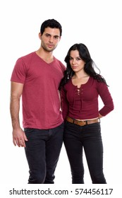 Studio shot of young couple standing together in love
