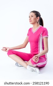 Studio shot of young fit woman doing yoga exercises