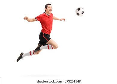 Studio shot of a young football player receiving a pass on his chest isolated on white background
