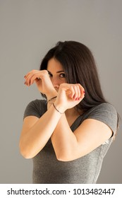 Studio shot of a young girl defending the face