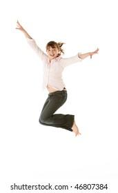 Studio Shot Of Young Girl Jumping In Studio
