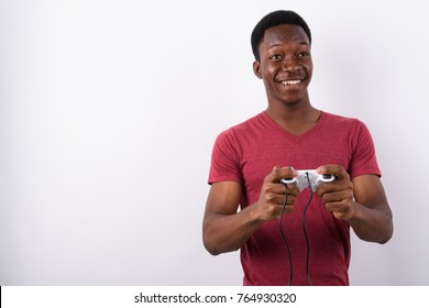 Studio shot of young handsome African man against white background