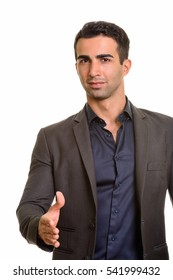 Studio shot of young handsome businessman giving handshake isolated against white background