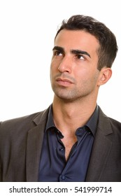 Studio shot of young handsome businessman thinking isolated against white background