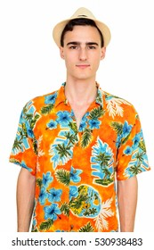 Studio shot of young handsome Caucasian man wearing Hawaiian shirt isolated against white background