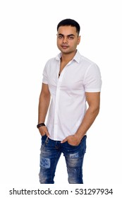 Studio shot of young handsome Indian man isolated against white background