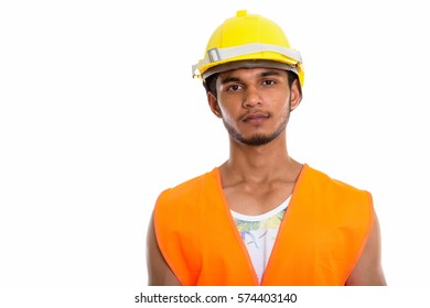 Studio shot of young handsome Indian man construction worker