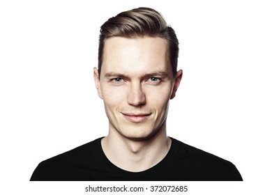 Studio shot of young handsome man with ironic smile. Isolated on white background.