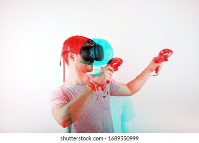 studio shot of a young, male model looking through virtual reality (VR) headset, immersed into his experience. isolated on white background. 3D anaglyph effect, glitch art with a double color exposure
