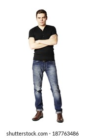 Studio shot of young man in black t-shirt and blue jeans.