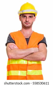 Studio shot of young man construction worker with arms crossed isolated against white background