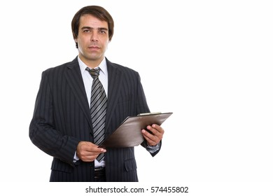 Studio shot of young Persian businessman holding clipboard