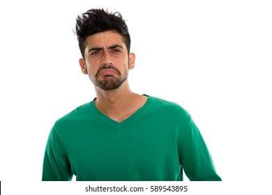 Studio shot of young Persian man looking sad
