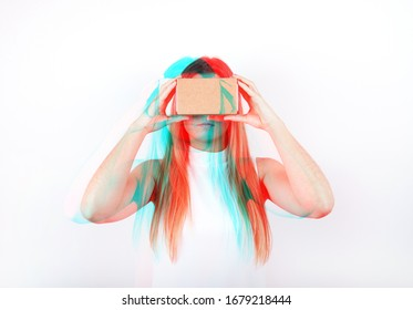studio shot of a young, professional female model looking through cardboard virtual reality (VR) headset, isolated on white. 3D anaglyph effect, glitch art.