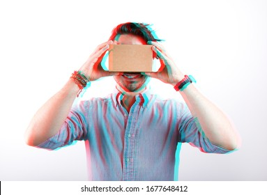 studio shot of a young, smiling model looking through cardboard virtual reality (VR) headset, isolated on white with 3D anaglyph effect, glitch art.