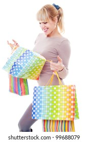 studio shot of young woman after shopping. isolated on white