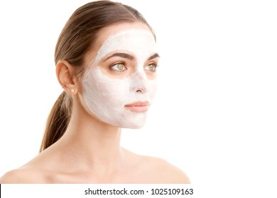 Studio shot of young woman wearing a face mask against at isolated background with copy space.