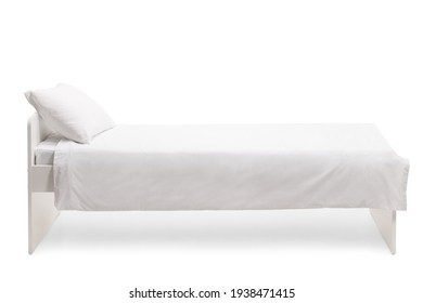 Studio side shot of a white single bed with duvet isolated on white background