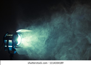 Studio spotlight using for background production film . silhouette blurred led lights with smoke in dark room . electric tools set for photography , video maker , cinematography