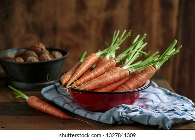 Studio Still Life with fresh Carrots and Walnuts