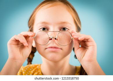 Studious Little Girl with Glasses, Isolated on Teal