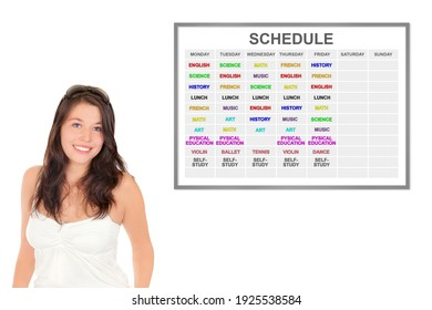 Studious schoolgirl in front of her full weekly schedule, isolated on white studio background