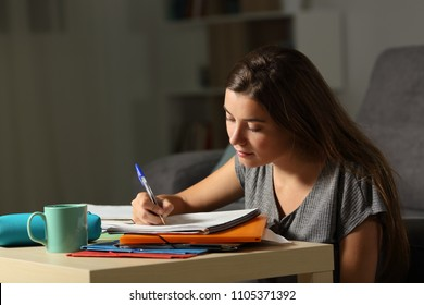 Studious student doing homework late hours in the night at home