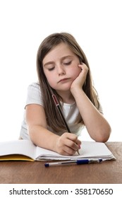 Studious young girl is trying hard with her homework