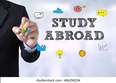 STUDY ABROAD Businessman drawing Landing Page on blurred abstract background