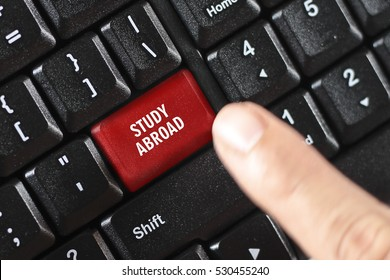study abroad words on red keyboard button