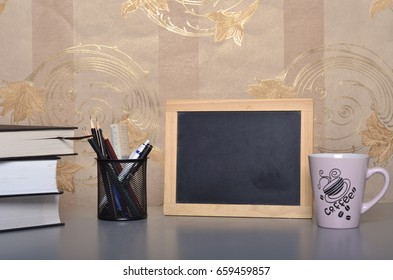 Study desk decoration with black board, books, black board and other stationary