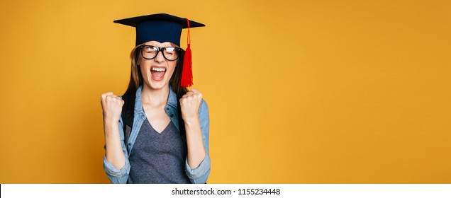Study, education, university, college, graduate concept on yellow banner. Happy and excited portrait of young blond student girl in hat of graduation isolated