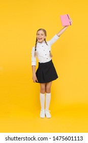 Study literature. Towards knowledge. Learn following rules. Welcome back to school. Inspirational quotes motivate kids for academic year ahead. School girl formal uniform hold book. School lesson.