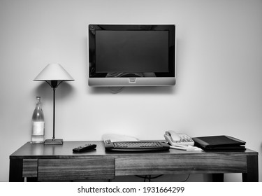 Study room with writing desk keyboard bottle phone lamp and lcd tv set