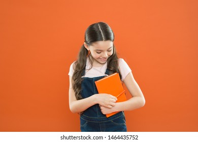 Study at school. First day at school. Ready for first lesson. September is here. Back to school. Child hold book. Interesting literature. Development and education. Child care and happy childhood.
