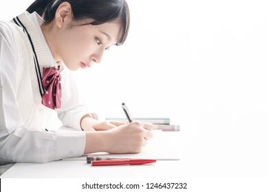 Studying asian school girl.