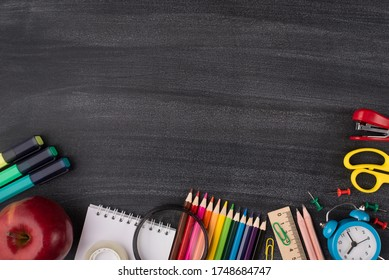 Studying and school concept. Top above overhead view photo of colorful stationery and an apple isolated on blackboard with copyspace empty place for text - Shutterstock ID 1748684747