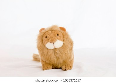 stuffed animal lion on a white background .
