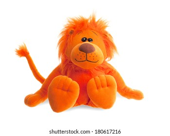 Stuffed animal lion sitting, isolated on a white background