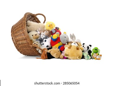 Stuffed animal toys in a basket, isolated on a white background